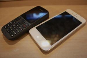 Nokia 100 and Apple iPhone 5