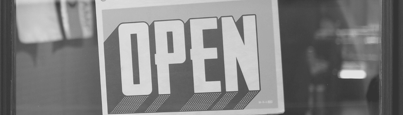 "A picture of an ""open"" sign in a shop window"