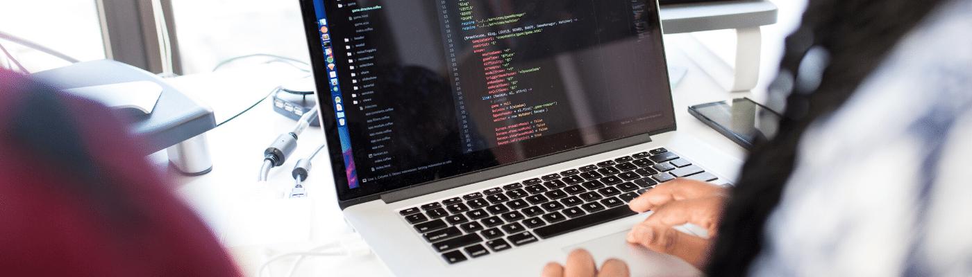 Engineer coding at computer