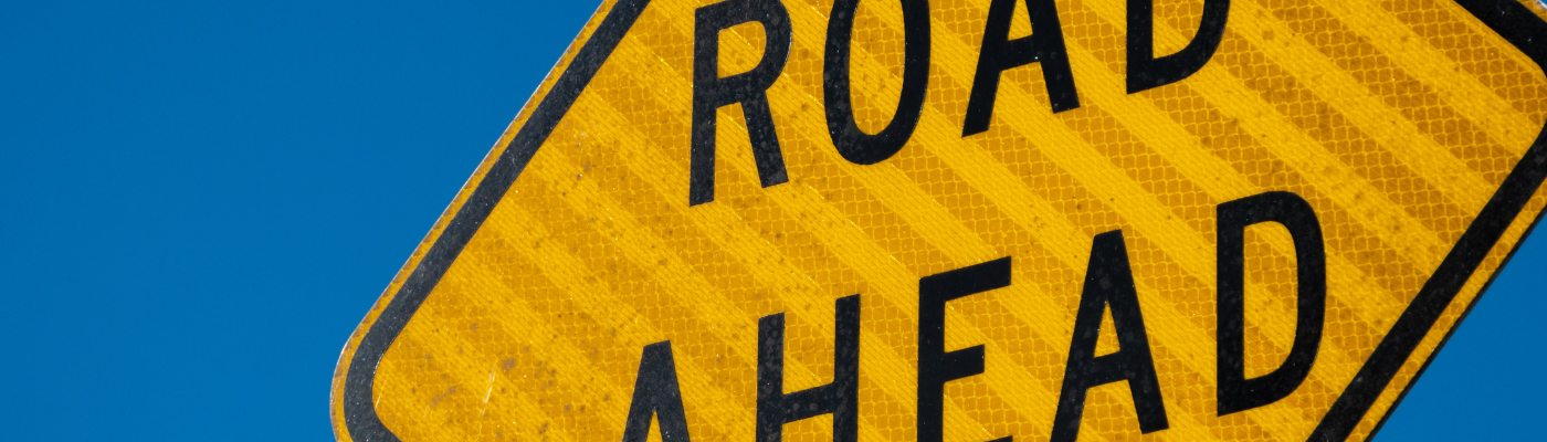 Road Ahead sign (a metaphor for the journey from idea to IPO)